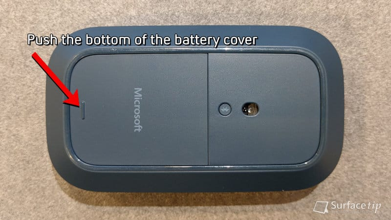 Push the Surface Mobile Mouse battery cover